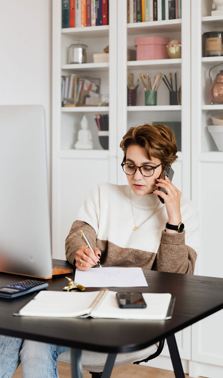 Woman uses a VoIP softphone app on her mobile to conduct business calls.
